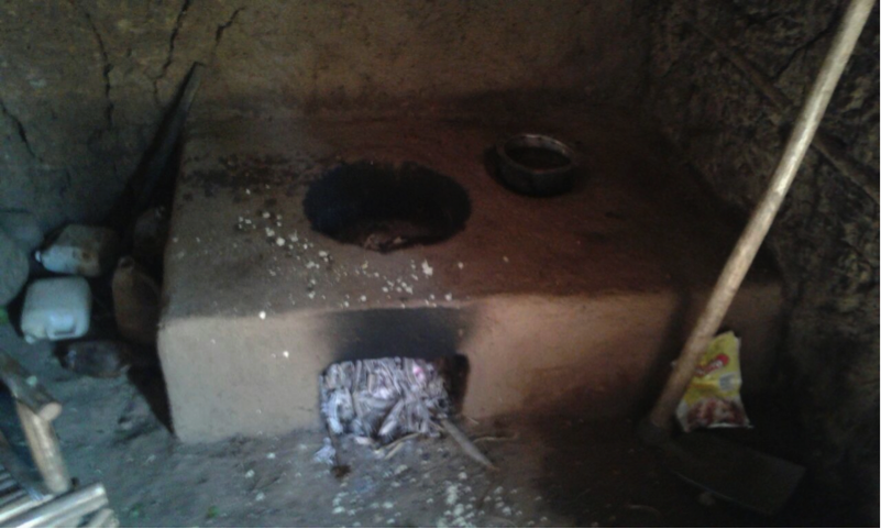 Esther Namutosi's mud stove, it simultaneously takes in two cooking pots with an outlet for smoke